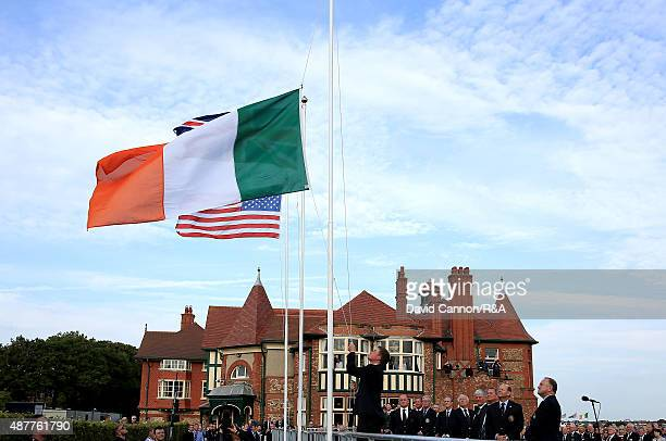 Paul Dunnes of Ireland and the Great Britain and Ireland team raises the Irish Flag at the Opening Ceremony of the 2015 Walker Cup Match at Royal...