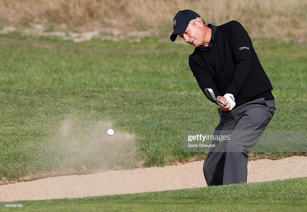 <a gi-track='captionPersonalityLinkClicked' href=/galleries/search?phrase=Paul+Eales&family=editorial&specificpeople=776401 ng-click='$event.stopPropagation()'>Paul Eales</a> of England hits from the bunker during the final round on day three of the WINSTONgolf Senior Open played at WINSTONgolf on September 8, 2013 in Schwerin, Germany.