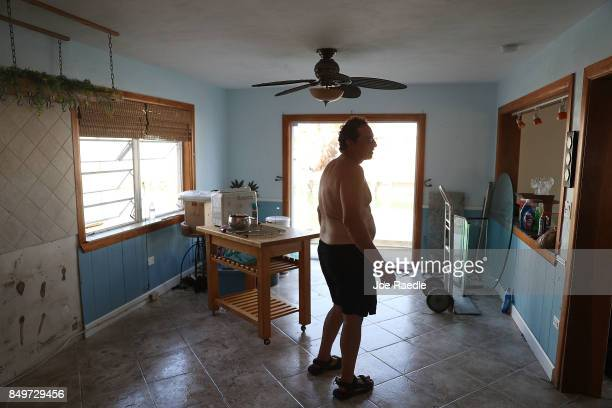 Paul Efron walks through a friends home as he helps him clean up after it was badly damaged by hurricane Irma on September 19 2017 in Marathon...