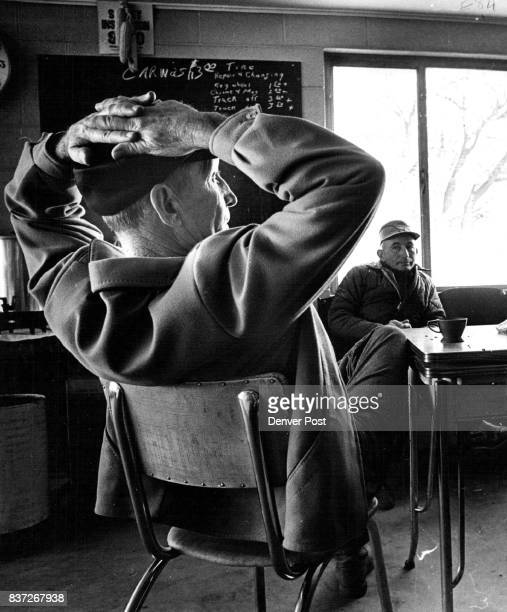 Paul Ehrlich foreground and Carl Winder Jr enjoy a cup of coffee in the mayor's service station With Mayor Wyman they find a fine place to relax...