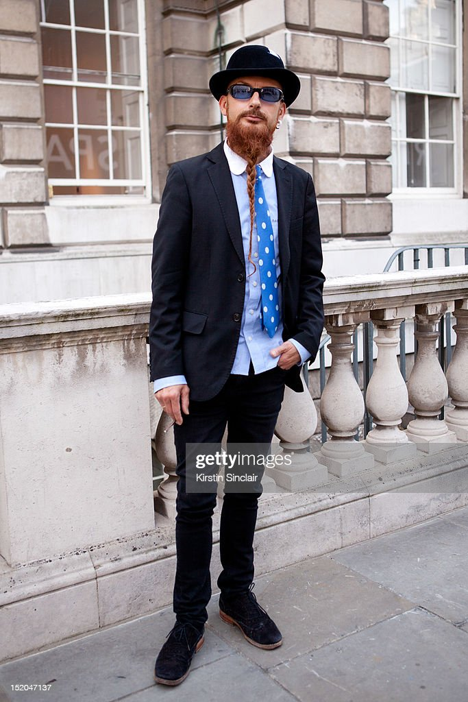 Paul Falther wearing a Hat by Stephen Jones, Abercorombie and Fitch shirt, John Lewis Tie, H and M Jacket, All Saints Trousers and Kurt Geiger shoes on day 2 of London Fashion Week Spring/Summer 2013, at Somerset House on September 15, 2012 in London, England.