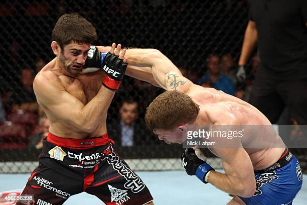Paul Felder lands a punch to the face of Jason Saggo of Canada in their lightweight bout at the Scotiabank Centre on October 4 2014 in Halifax Nova...