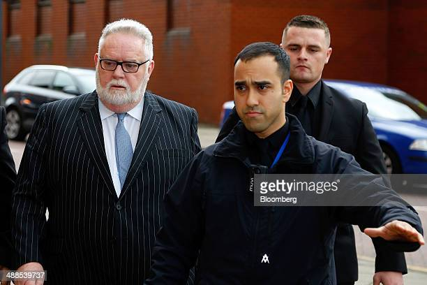 Paul Flowers former chairman of CoOperative Bank Plc left arrives at Leeds Magistrates Court in Leeds UK on Wednesday May 7 2014 Flowers the former...