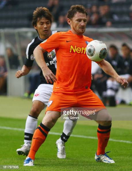 Paul Freier of Bochum is challenged by Takashi Inui of Frankfurt during the DFB Cup second round match between Eintracht Frankfurt and VfL Bochum at...