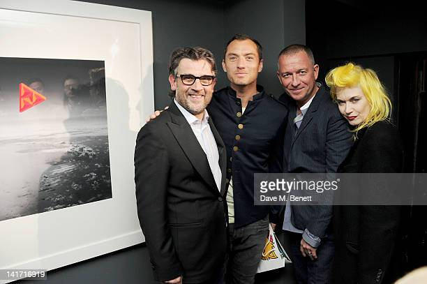 Paul Fryer Jude Law Sean Pertwee and Pam Hogg attend a private viewing of artist Paul Fryer's exhibit 'The Electric Sky' at Pertwee Anderson Gold...