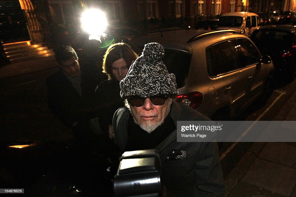 Paul Gadd, aka '<a gi-track='captionPersonalityLinkClicked' href=/galleries/search?phrase=Gary+Glitter&family=editorial&specificpeople=228004 ng-click='$event.stopPropagation()'>Gary Glitter</a>' arrives back at his apartment after being arrested by London police for questioning in connection with the Jimmy Savile scandal on October 28, 2012 in London, England. Police arrested the former pop star and convicted sex offender as part of their investigation into allegations of sexual abuse by Jimmy Savile.