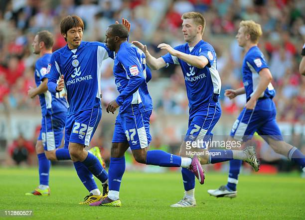 Paul Gallagher and Yuki Abe congratulate Darius Vassell of Leicester after he scores to make it 22 during the npower Championship match between...