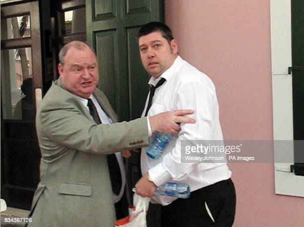 Paul Gallagher father of twoyearold Paul Gallagher being held back by his brotherinlaw John McGuckion outside the Supreme Court in Nassau Bahamas