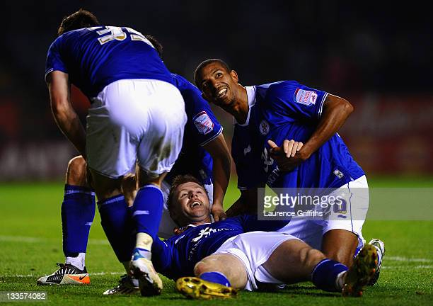 Paul Gallagher of Leicester celebrates the third goal with David Nugent and Jermaine Beckford during the npower Championship match between Leicester...