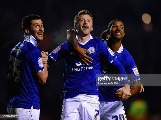Paul Gallagher of Leicester City celebrates the third goal with David Nugent and Jermaine Beckford during the npower Championship match between...