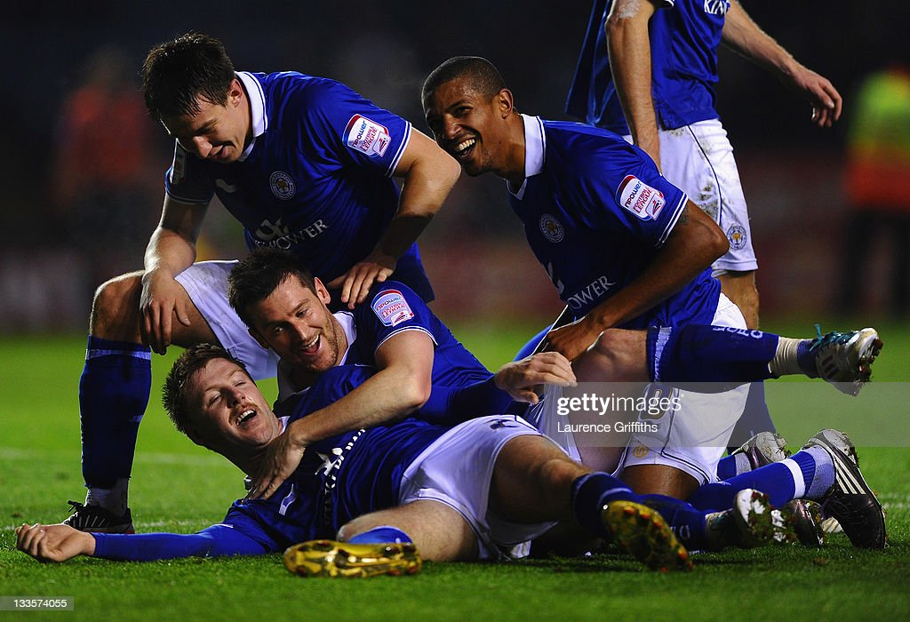 <a gi-track='captionPersonalityLinkClicked' href=/galleries/search?phrase=Paul+Gallagher+-+Soccer+Forward&family=editorial&specificpeople=13650994 ng-click='$event.stopPropagation()'>Paul Gallagher</a> of Leicester City celebrates the third goal with <a gi-track='captionPersonalityLinkClicked' href=/galleries/search?phrase=David+Nugent+-+Soccer+Player&family=editorial&specificpeople=644849 ng-click='$event.stopPropagation()'>David Nugent</a> and <a gi-track='captionPersonalityLinkClicked' href=/galleries/search?phrase=Jermaine+Beckford&family=editorial&specificpeople=3132377 ng-click='$event.stopPropagation()'>Jermaine Beckford</a> during the npower Championship match between Leicester City and Crystal Palace at Walkers Stadium on November 20, 2011 in Leicester, England.
