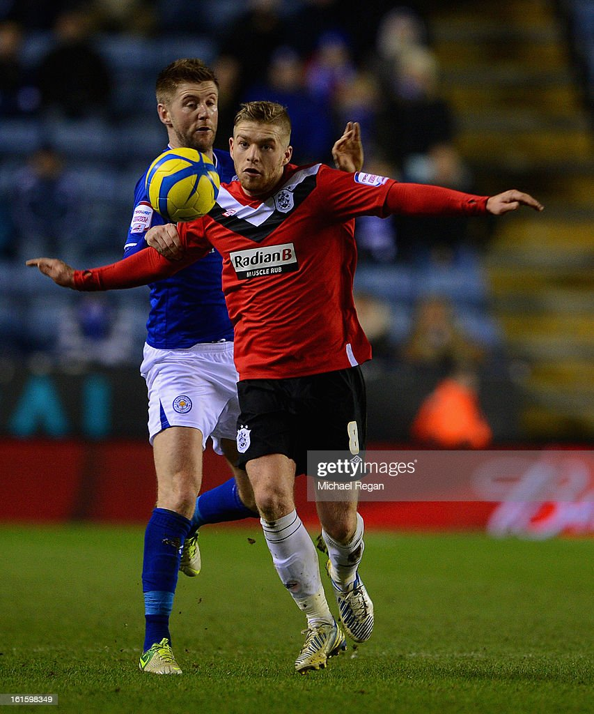 Paul Gallagher of Leicester in action with Adam Clayton of Huddersfield during the FA Cup Fourth Round Replay between Leicester City and Huddersfield Town at The King Power Stadium on February 12, 2013 in Leicester, England.