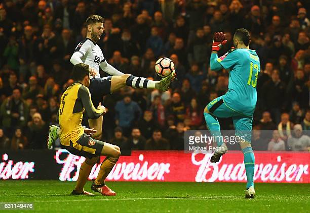 Paul Gallagher of Preston North End takes on David Ospina and Gabriel of Arsenal during the Emirates FA Cup Third Round match between Preston North...