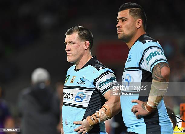 Paul Gallen and Andrew Fifita of the Sharks look on during the round 26 NRL match between the Melbourne Storm and the Cronulla Sharks at AAMI Park on...
