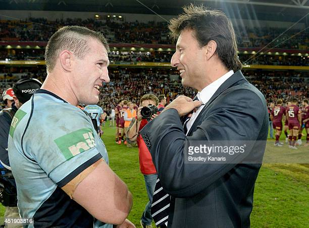 Paul Gallen and Coach Laurie Daley of the Blues celebrate a series win after game three of the State of Origin series between the Queensland Maroons...