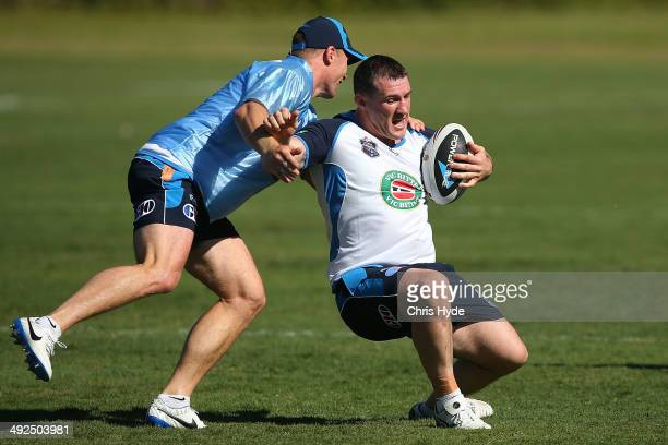 Paul Gallen is tackled by Beau Scott during a New South Wales Blues State of Origin training session at Novotel Coffs Harbour on May 21 2014 in Coffs...