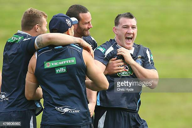 Paul Gallen laughs with team mates during the New South Wales Blues State of Origin team training session at the Novotel on June 11 2015 in Coffs...