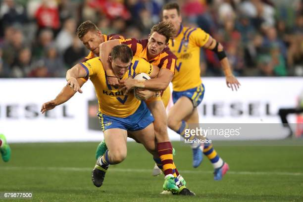 Paul Gallen of City is tackled by Tariq Sims and Connor Watson of Country during the 2017 City versus Country Origin match at Glen Willow Sports...