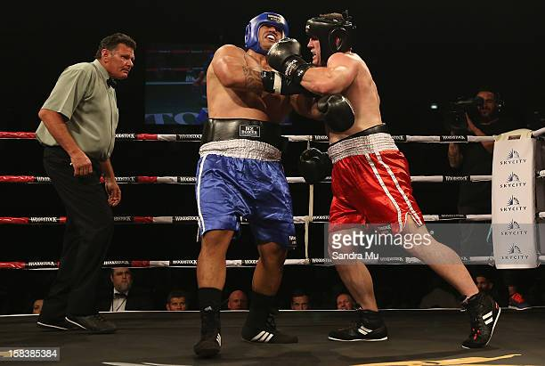 Paul Gallen of league punches Hika Elliott of rugby during the bout between Paul Gallen and Hika Elliott during the 2012 Fight for Life at Trusts...