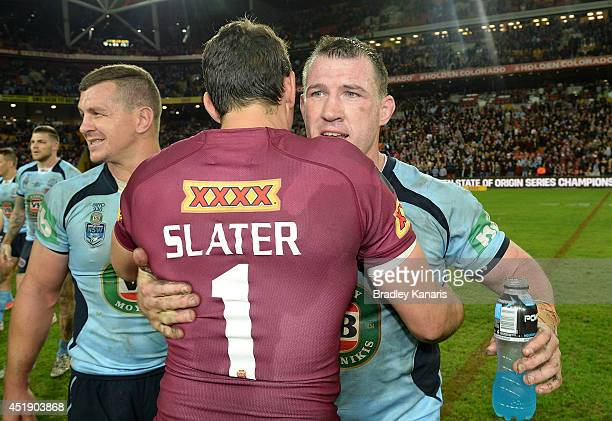 Paul Gallen of the Blues and Billy Slater of the Maroons embrace after game three of the State of Origin series between the Queensland Maroons and...