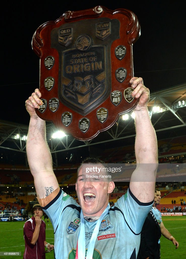 Paul Gallen of the Blues celebrates an Origin series victory as he holds up the winners shield after game three of the State of Origin series between...