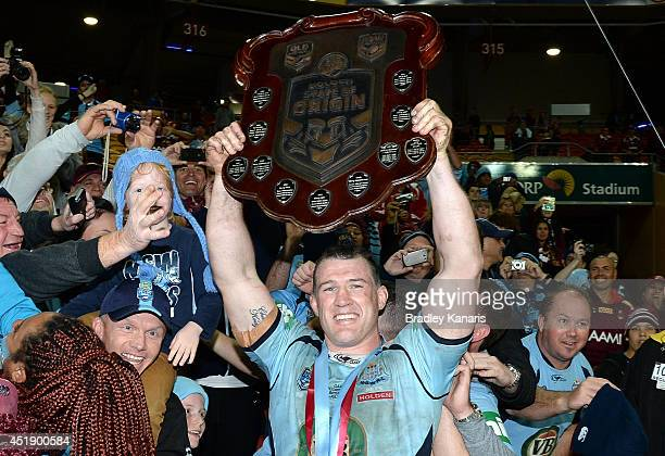 Paul Gallen of the Blues celebrates an Origin series victory with fans after game three of the State of Origin series between the Queensland Maroons...