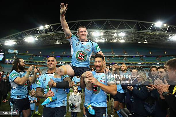 Paul Gallen of the Blues is chaired off the field after playing his final Origin game celeabrating winning game three of the State Of Origin series...