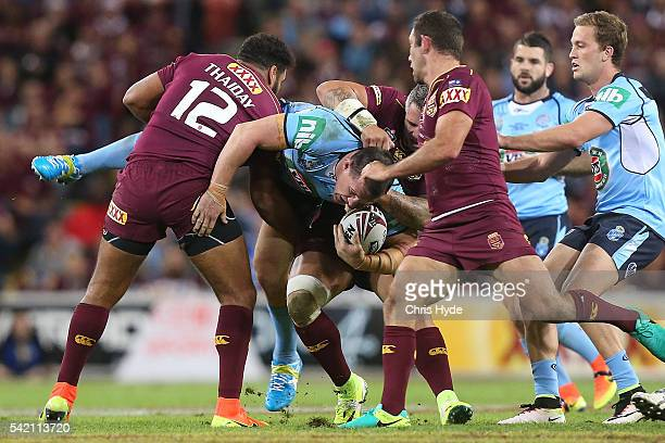 Paul Gallen of the Blues is tackled by Sam Thaiday and Corey Parker of the Maroons during game two of the State Of Origin series between the...