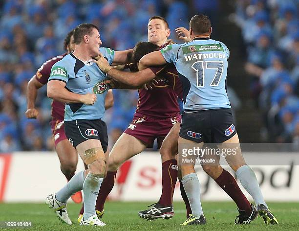 Paul Gallen of the Blues punches Nate Myles of the Maroons during game one of the ARL State of Origin series between the New South Wales Blues and...