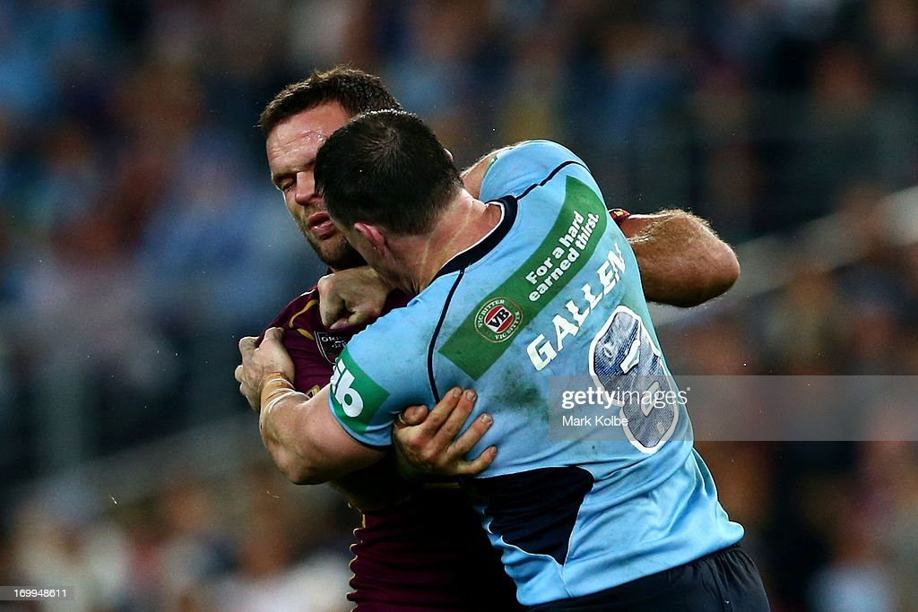 <a gi-track='captionPersonalityLinkClicked' href=/galleries/search?phrase=Paul+Gallen&family=editorial&specificpeople=240584 ng-click='$event.stopPropagation()'>Paul Gallen</a> of the Blues punches <a gi-track='captionPersonalityLinkClicked' href=/galleries/search?phrase=Nate+Myles&family=editorial&specificpeople=546460 ng-click='$event.stopPropagation()'>Nate Myles</a> of the Maroons during game one of the ARL State of Origin series between the New South Wales Blues and the Queensland Maroons at ANZ Stadium on June 5, 2013 in Sydney, Australia.