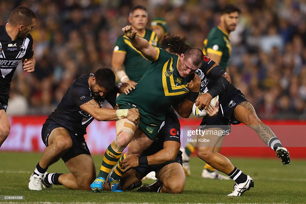 <a gi-track='captionPersonalityLinkClicked' href=/galleries/search?phrase=Paul+Gallen&family=editorial&specificpeople=240584 ng-click='$event.stopPropagation()'>Paul Gallen</a> of the Kanagroos is tackled during the International Rugby League Trans Tasman Test match between the Australian Kangaroos and the New Zealand Kiwis at Hunter Stadium on May 6, 2016 in Newcastle, Australia.