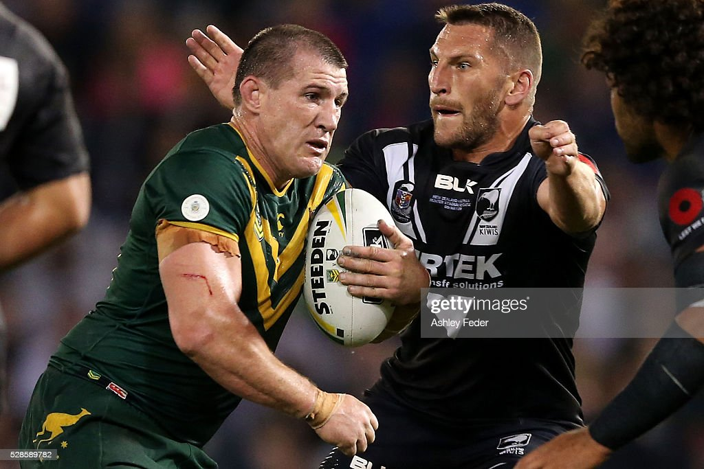 <a gi-track='captionPersonalityLinkClicked' href=/galleries/search?phrase=Paul+Gallen&family=editorial&specificpeople=240584 ng-click='$event.stopPropagation()'>Paul Gallen</a> of the Kangaroos is tackled by Lewis Brown of the Kiwis during the International Rugby League Trans Tasman Test match between the Australian Kangaroos and the New Zealand Kiwis at Hunter Stadium on May 6, 2016 in Newcastle, Australia.