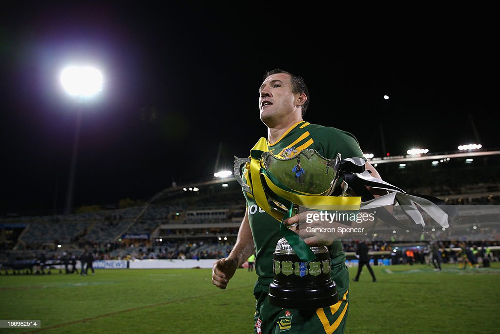 Paul Gallen of the Kangaroos runs to the crowd with the trophy after winning the ANZAC Test match between the Australian Kangaroos and the New Zealand Kiwis at Canberra Stadium on April 19, 2013 in Canberra, Australia.