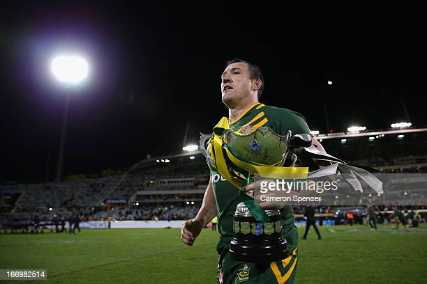 Paul Gallen of the Kangaroos runs to the crowd with the trophy after winning the ANZAC Test match between the Australian Kangaroos and the New...