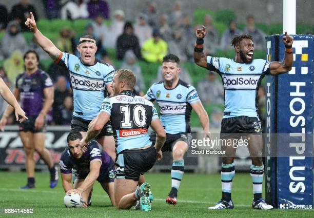 Paul Gallen of the Sharks and his teammates celebrate after James Segeyaro of the Sharks scored the matchwinning try as Billy Slater of the Melbourne...