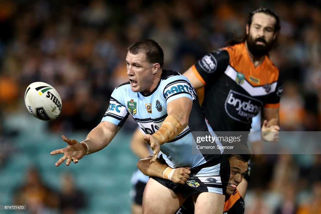 Paul Gallen of the Sharks is tackled during the round nine NRL match between the Wests Tigers and the Cronulla Sharks at Leichhardt Oval on April 29, 2017 in Sydney, Australia.