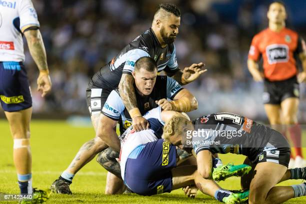 Paul Gallen of the Sharks lays a tackle during the round eight NRL match between the Cronulla Sharks and the Gold Coast Titans at Southern Cross...