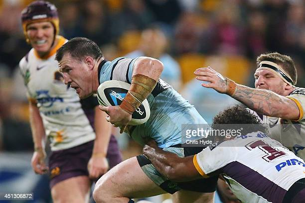Paul Gallen of the Sharks makes a break during the round 16 NRL match between the Brisbane Broncos and the Cronulla Sharks at Suncorp Stadium on June...