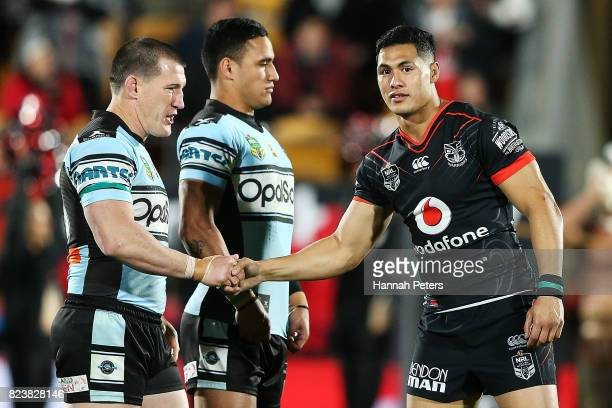 Paul Gallen of the Sharks shakes hands with Roger TuivasaSheck of the Warriors ahead of the round 21 NRL match between the New Zealand Warriors and...