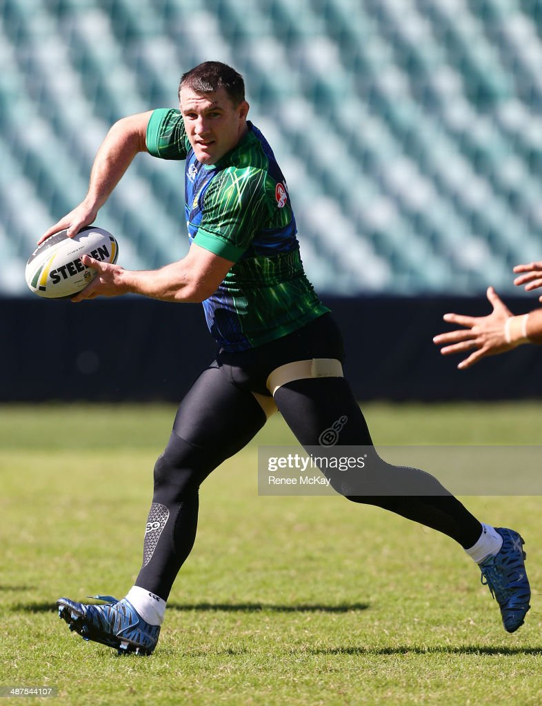 <a gi-track='captionPersonalityLinkClicked' href=/galleries/search?phrase=Paul+Gallen&family=editorial&specificpeople=240584 ng-click='$event.stopPropagation()'>Paul Gallen</a> passes the ball during an Australian Kangaroos Captain's Run at Allianz Stadium on May 1, 2014 in Sydney, Australia.