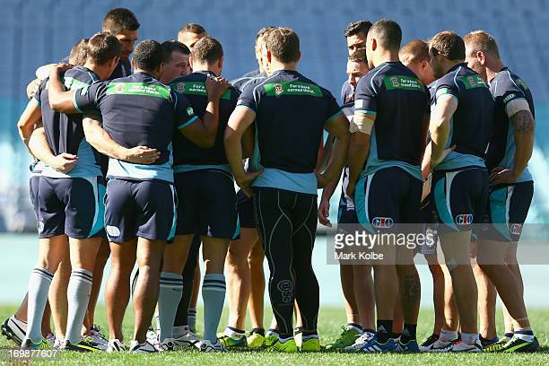 Paul Gallen speaks to the Blues team as they form a huddle during a New South Wales Blues state of origin training session at ANZ Stadium on June 4...