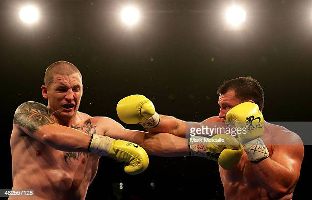 Paul Gallen throws a right at Randall Rayment during their heavyweight bout during the Footy Show Fight Night at Allphones Arena on January 31 2015...