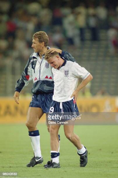 Paul Gascoigne of England bursts into tears and is consoled by tea mate Terry Butcher after losing the FIFA World Cup Finals 1990 SemiFinal match...