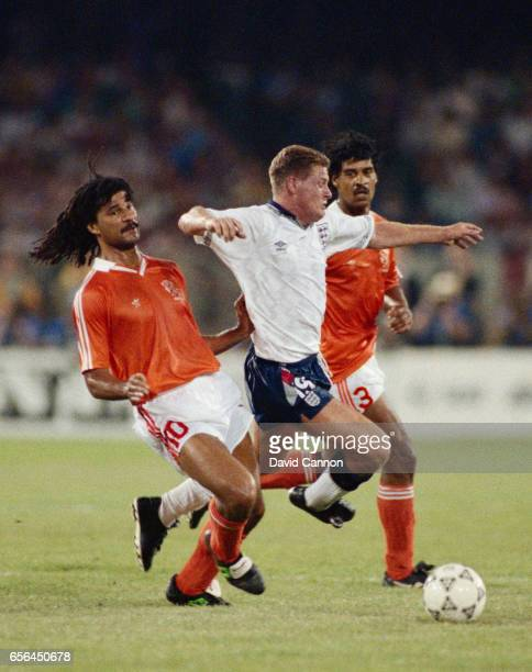 Paul Gascoigne of England holds off the challenges of Ruud Gullit and Frank Rijkaard of the Netherlands during the FIFA World Cup Finals 1990 group...