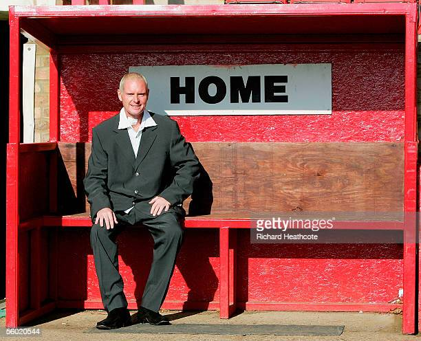 Paul Gascoigne poses in the home dugout as he is announced as manager of Kettering Town as his consortium takes over the club after having an offer...