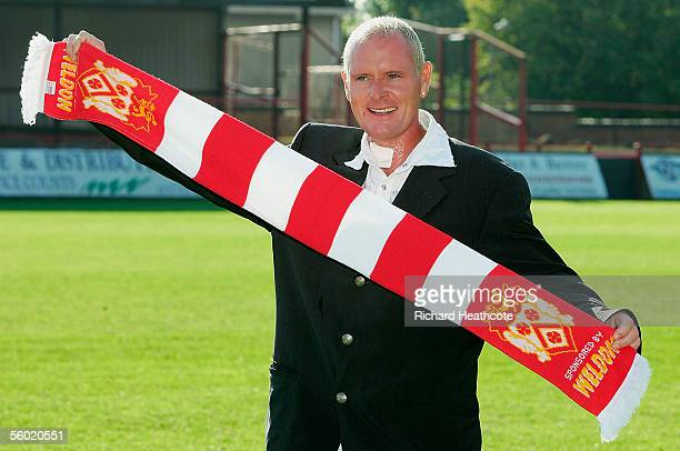 Paul Gascoigne poses with a team scarf as he is announced as manager of Kettering Town as his consortium takes over the club after having an offer...