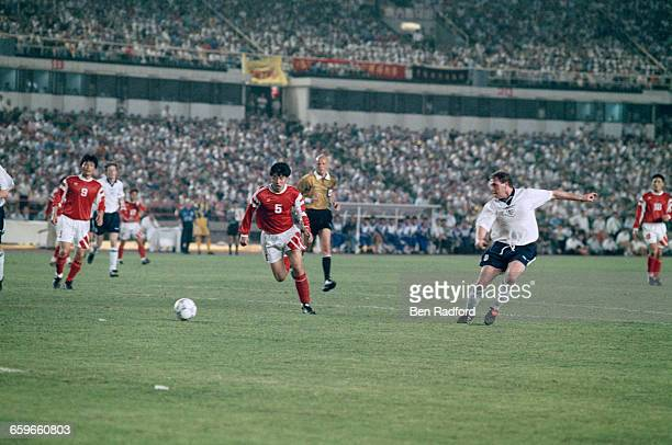 Paul Gascoigne scores England's third goal in an International Friendly Match against China at the Workers' Stadium in Beijing during the England...