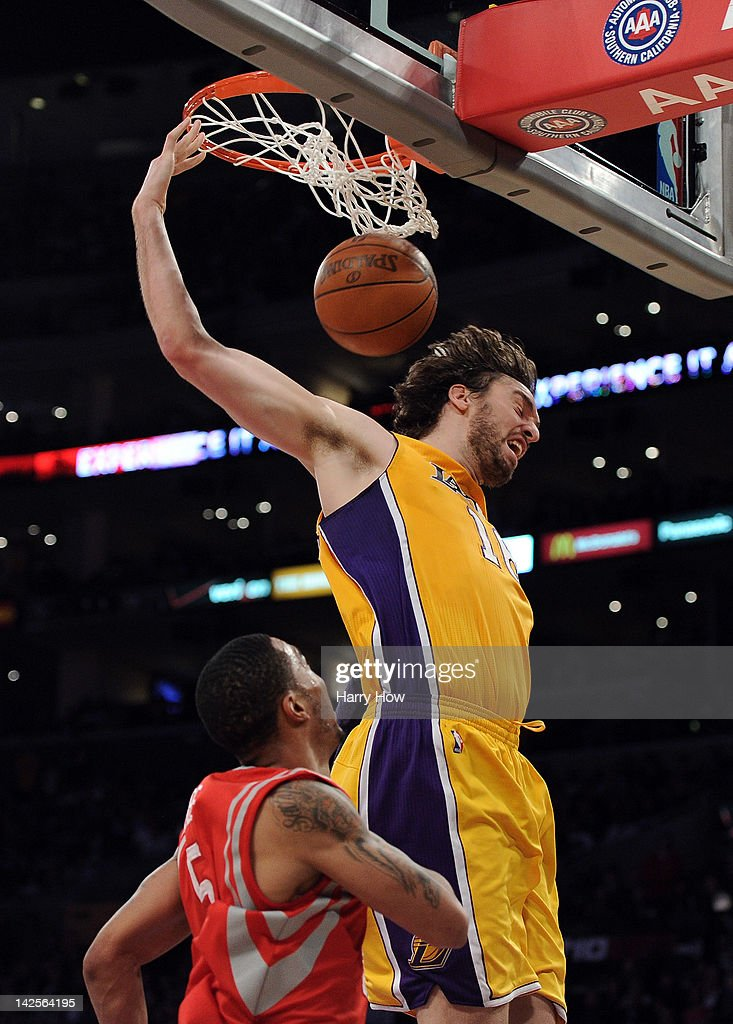 Paul Gasol #16 of the Los Angeles Lakers scores on a dunk in front of <a gi-track='captionPersonalityLinkClicked' href=/galleries/search?phrase=Courtney+Lee&family=editorial&specificpeople=730223 ng-click='$event.stopPropagation()'>Courtney Lee</a> #5 of the Houston Rockets at Staples Center on April 6, 2012 in Los Angeles, California.
