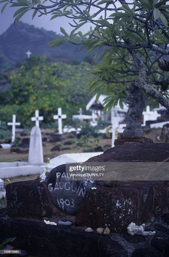 <a gi-track='captionPersonalityLinkClicked' href=/galleries/search?phrase=Paul+Gauguin&family=editorial&specificpeople=99058 ng-click='$event.stopPropagation()'>Paul Gauguin</a>'s grave, Atunoa cemetery on Hiva Hoa island, Marquesas archipelago in French Polynesia - In this cemetery are the graves of the painter <a gi-track='captionPersonalityLinkClicked' href=/galleries/search?phrase=Paul+Gauguin&family=editorial&specificpeople=99058 ng-click='$event.stopPropagation()'>Paul Gauguin</a> and the singer <a gi-track='captionPersonalityLinkClicked' href=/galleries/search?phrase=Jacques+Brel&family=editorial&specificpeople=769484 ng-click='$event.stopPropagation()'>Jacques Brel</a>.
