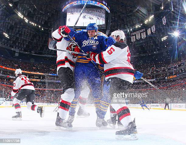 Paul Gaustad of the Buffalo Sabres charges to the net trying to squeeze between Andy Greene and David Steckel of the New Jersey Devils at HSBC Arena...